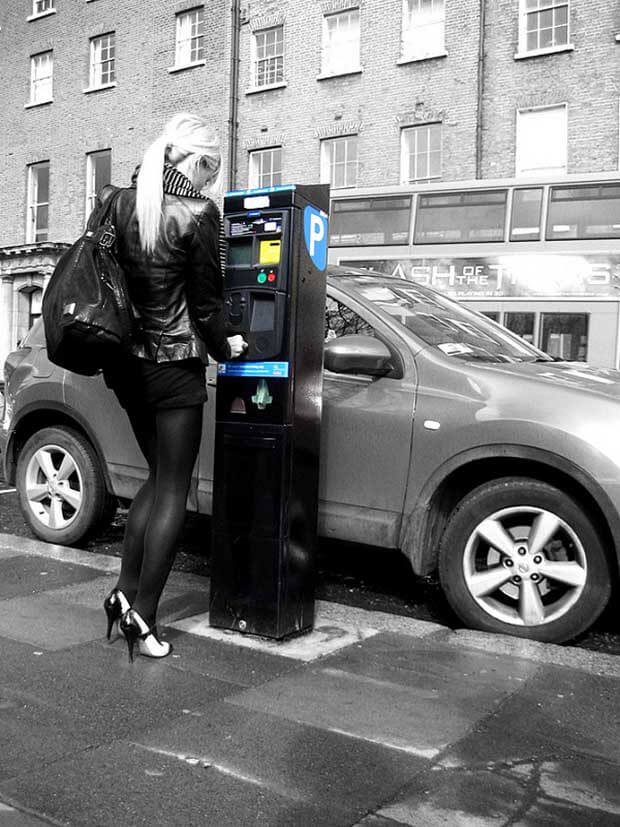 Girl at parking meter Dublin