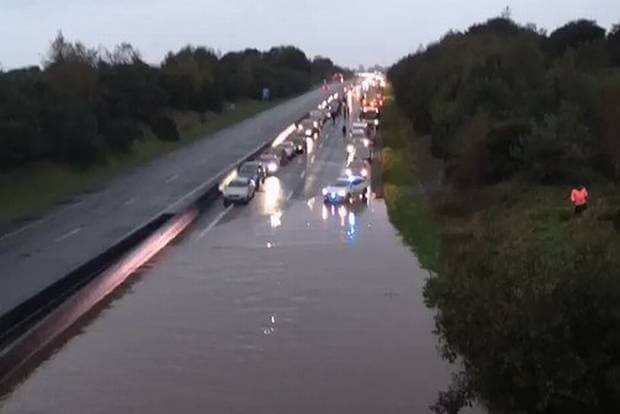 Total chaos on M8 Motorway after heavy rains flood carriageway causing a massive tailback